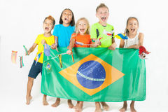 Group of children holding a Brazil flag Royalty Free Stock Photography