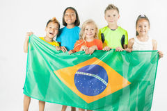 Group of children holding a Brazil flag Stock Image