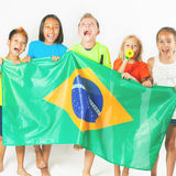 Group of children holding a Brazil flag Royalty Free Stock Photo