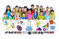 Group of Children Holding Education Concept Billboard.  royalty free stock photography