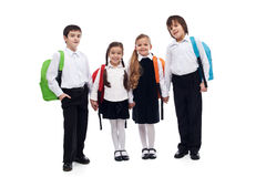 Group of children holding hands going back to school. Group of children with colorful backpacks holding hands - back to school concept Royalty Free Stock Photos