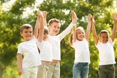 Group of children holding hands up. Volunteer project stock images