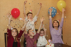 A group of children in holiday caps at a children& x27;s party. Children have fun together on a family holiday. Stock Image