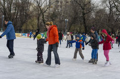 Group of children ice skating Royalty Free Stock Photo