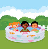 Group of children in an inflatable pool Royalty Free Stock Image