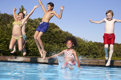 Group Of Children Jumping Into Outdoor Swimming Pool Stock Photos
