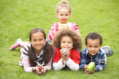 Group Of Children Laying On Grass With Easter Eggs Royalty Free Stock Photo