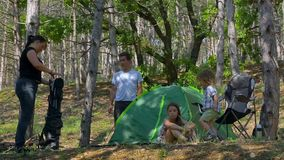 Group of children laying in tent stock video
