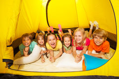 Group of children laying in a tent Royalty Free Stock Image