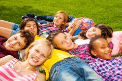Group of children laying together and smile Stock Photos