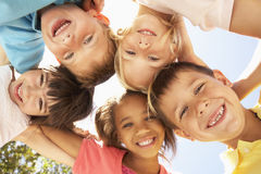 Group Of Children Looking Down Into Camera Stock Image