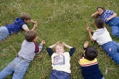 A group of children lying on the grass, Royalty Free Stock Photos