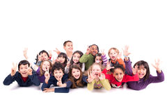 Group of children making faces. Group of children making funny faces isolated in white Royalty Free Stock Images