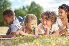 Group of children in nature. Having fun stock photography