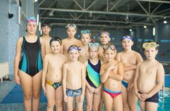 Group of children near a swimming pool. Healthy and happy childhood concept. Sportive kids activity in modern sport center Royalty Free Stock Photography