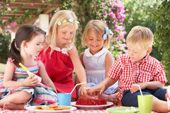 Group Of Children At Outdoor Tea Party Stock Photos