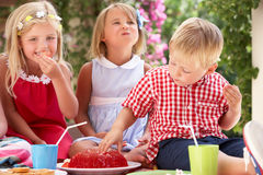 Group Of Children At Outdoor Tea Party Royalty Free Stock Image