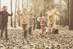 Group of children in the park. Large group of children running through the park royalty free stock photos