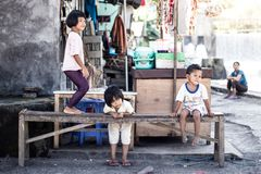 Group of children play on the street in developing countries stock image