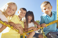 Group Of Children Playing On Climbing Frame Stock Photography