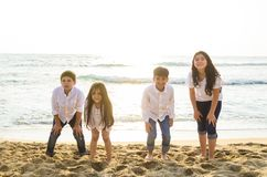 Group of children playing at the edge of the sea. royalty free stock photo