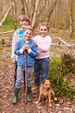 Group Of Children Playing In Forest With Dog Royalty Free Stock Photo
