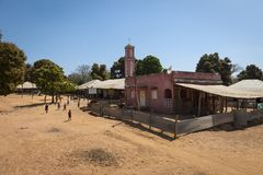 Group of children playing in front of a mosque at the village of Mandina Mandinga in the Gabu Region. Gabu Region, Republic of Guinea-Bissau - February 7, 2018 stock image