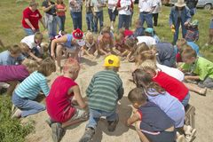 Group of children playing a game in the sand Royalty Free Stock Photo