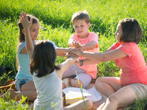 Group of children playing on grass Royalty Free Stock Photography