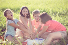 Group of children playing on grass Royalty Free Stock Photo