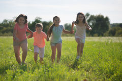 Group of children playing on grass Royalty Free Stock Image