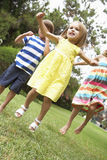 Group Of Children Playing Outdoors Together Royalty Free Stock Images