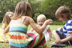 Group Of Children Playing Outdoors Together Stock Photos