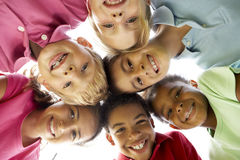 Group Of Children Playing In Park. Looking Down Smiling royalty free stock photo