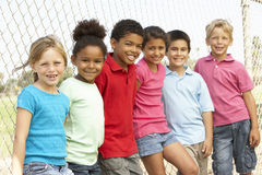Group Of Children Playing In Park. Smiling stock photo