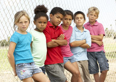Group Of Children Playing In Park. Group Of Children In Park Looking Serious royalty free stock image