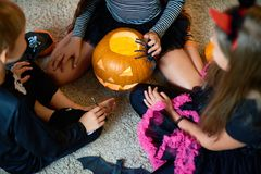 Group of Children Playing with Pumpkin on Halloween Stock Photography