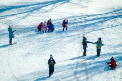 Group of children playing on snow in winter time. Togetherness, vacations, kid Royalty Free Stock Images