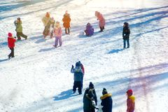 Group of children playing on snow in winter time. Togetherness, vacations, kid Stock Images