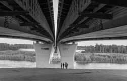 Group of Children Playing Under a Bridge Stock Photos