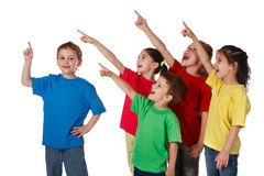 Group of children with pointing up sign royalty free stock images