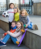 Group of children portrait with ball and skateboard Royalty Free Stock Images