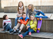 Group of children portrait with ball and skateboard Stock Photos