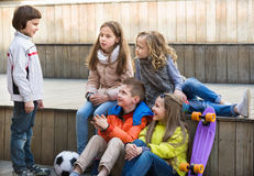 Group of children portrait with ball and skateboard Stock Photography