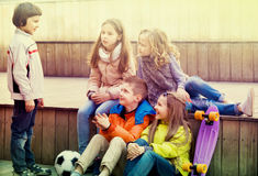 Group of children portrait with ball and skateboard Royalty Free Stock Image