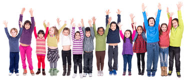 Group of children. Posing with raised hands isolated in white Royalty Free Stock Photos
