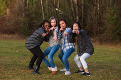 Group of children posing together for girl power Royalty Free Stock Photography