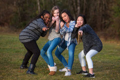 Group of children posing together for girl power Royalty Free Stock Images