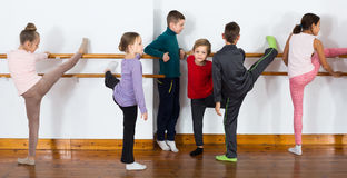 Group of children practicing at the ballet barre Stock Photography