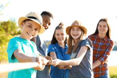Group of children pulling rope during tug of war. Game outdoors. Summer camp Royalty Free Stock Image